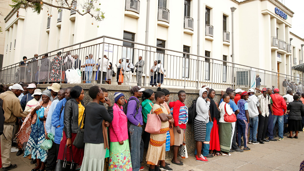 People queue to withdraw money from a bank as Zimbabwe introduces new currency in Harare, Zimbabwe, November 12, 2019