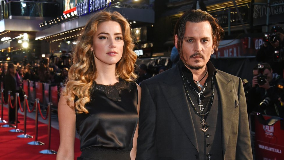 "Amber Heard (L) and Johnny Depp attend the Virgin Atlantic gala screening of ""Black Mass"" during the BFI London Film Festival"
