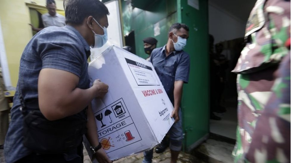 "Workers unload boxes containing a COVID-19 vaccine from a truck to a storage building, upon the arrival of Sinovac""s COVID-19 vaccine in Banda Aceh, Indonesia, 12 January 2021. I"