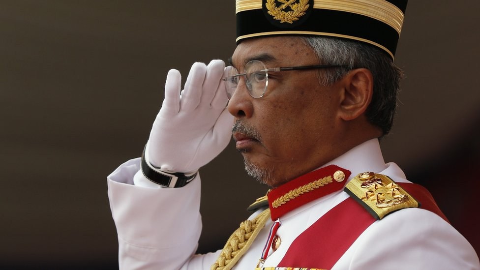 """The King of Malaysia Sultan Abdullah Sultan Ahmad Shah salutes during the Trooping the Color ceremony, held in conjunction with the national day of celebration of the Malaysian King""""s birthday on 09 September; in Putrajaya, Malaysia, 12 September 2019"""