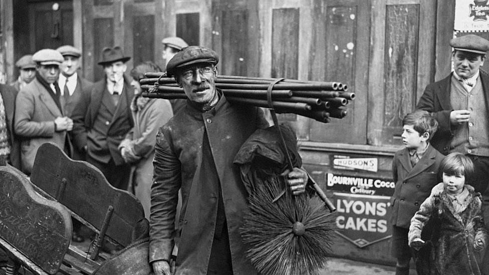 A chimney sweep in Bethnal Green in east London going to his morning's work, 1931