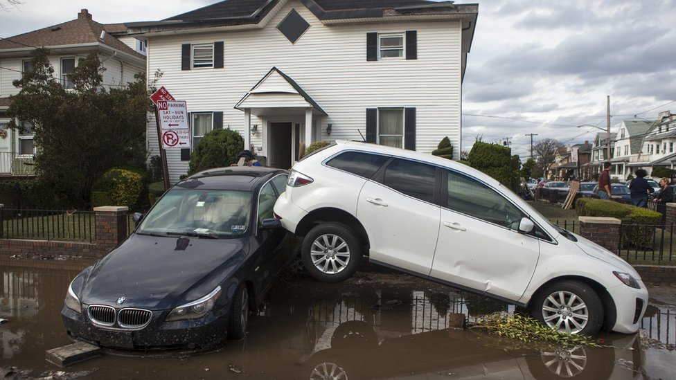 Cars in water and stacked after Hurricane Sandy
