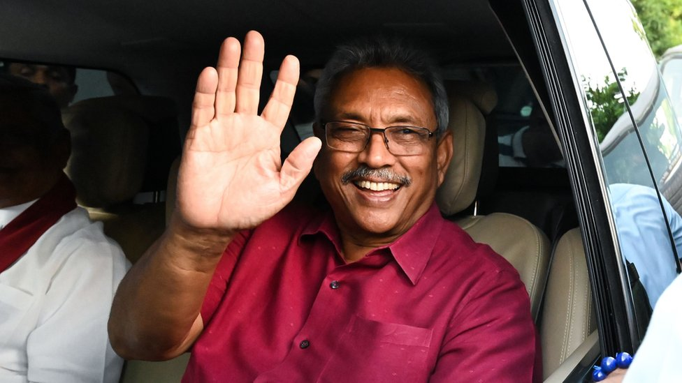 Gotabaya Rajapaksa waving to supporters out of a car window after his election victory was announced