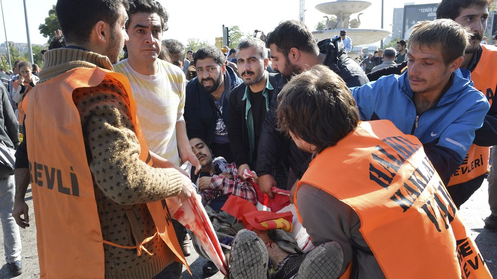 People helping someone wounded in explosions in Ankara, Turkey, Saturday 10 October 2015