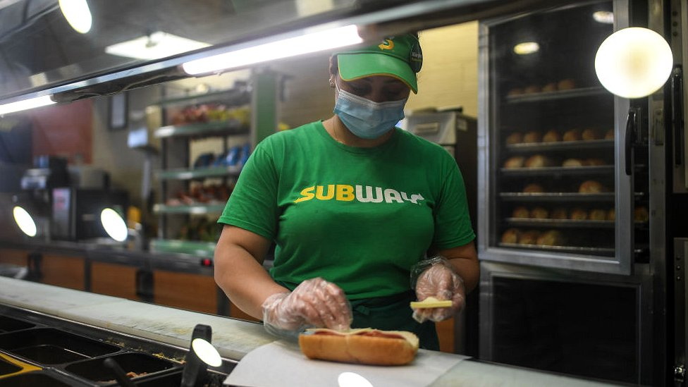 Subway employee makes sandwich