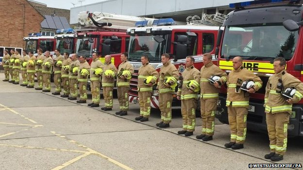 Firefighters from West Sussex Fire and Rescue service observed a minute's silence