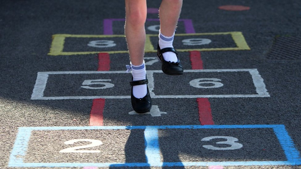 File picture of a girl playing hopscotch