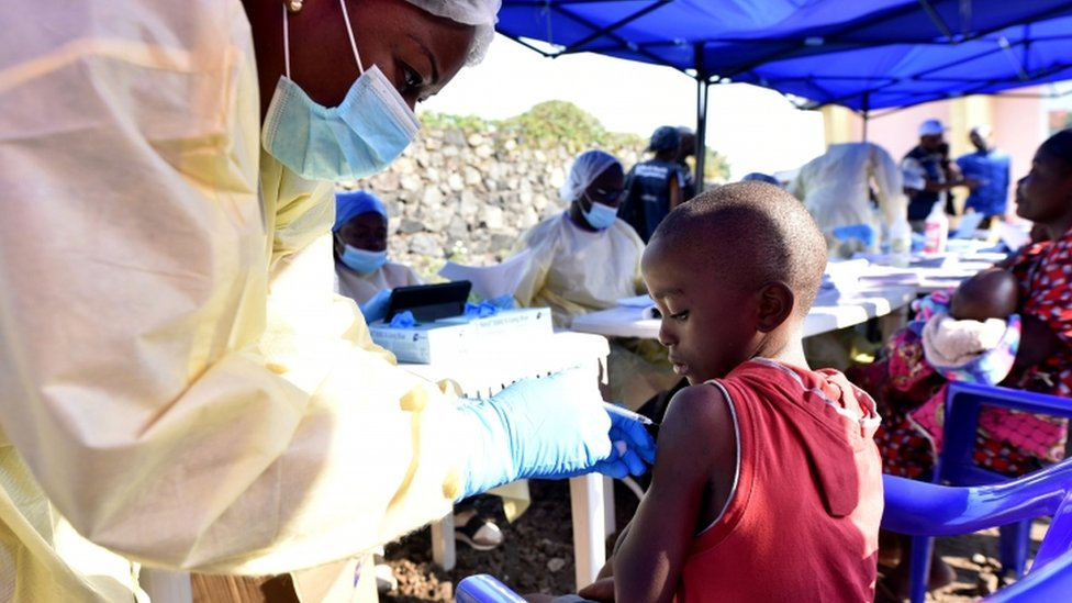 A Congolese health worker administers an Ebola vaccine to a child in the Democratic Republic of Congo