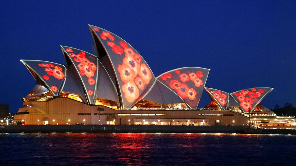 Red poppies are projected on to the sails of the Sydney Opera House