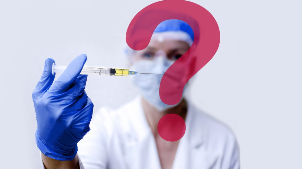 An image of a health worker injecting a question mark