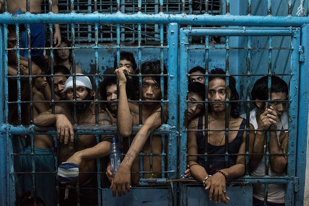 A police cell crowded with prisoners