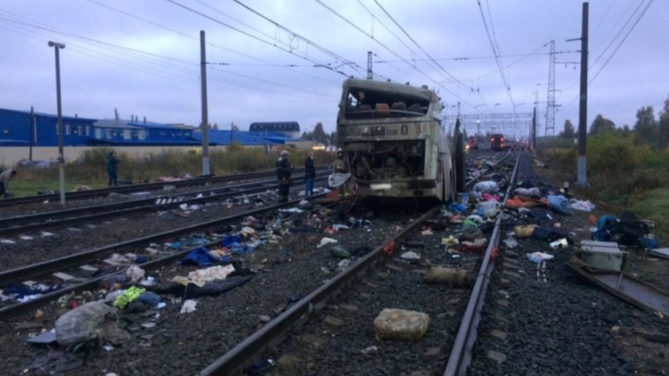 The other half of bus can be seen with passengers belongings surrounding