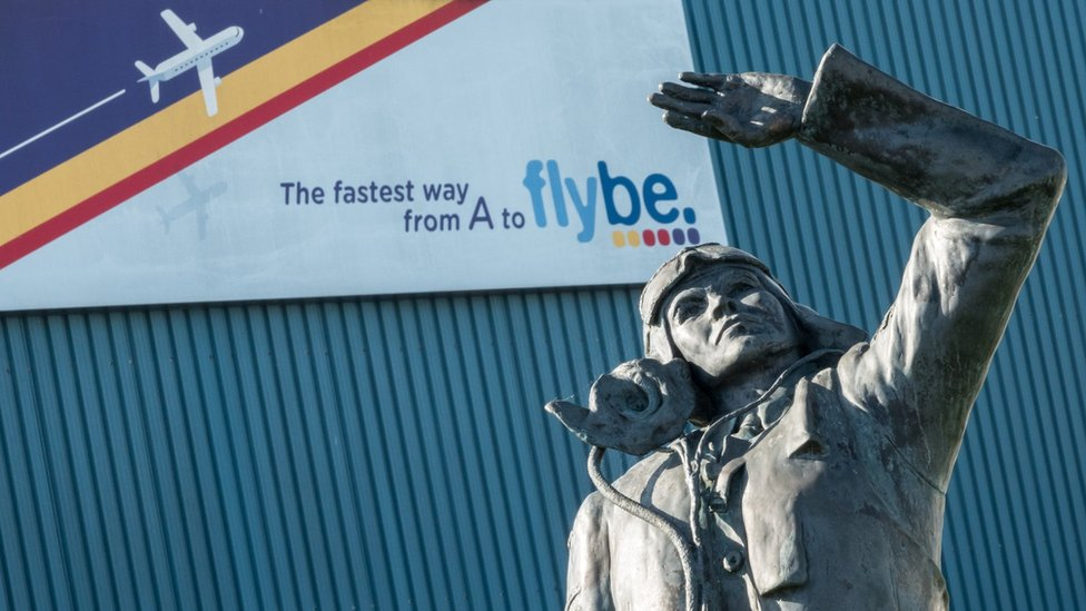 Aviator in front of Flybe sign