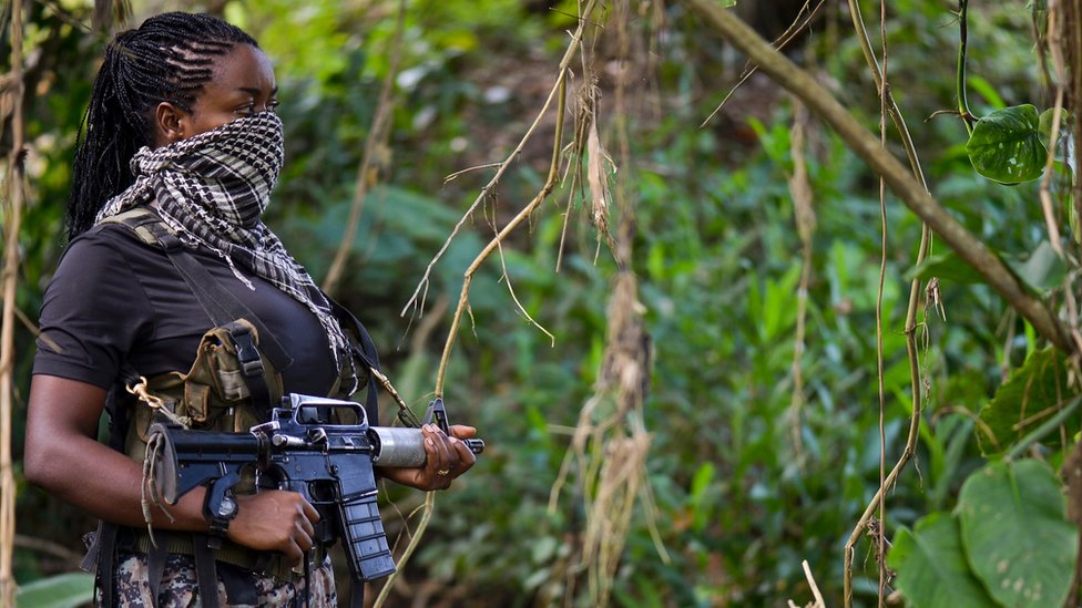This photo taken on January 26, 2017 shows a ELN member guarding the area as AFP conducts an interview in Alto Baudo