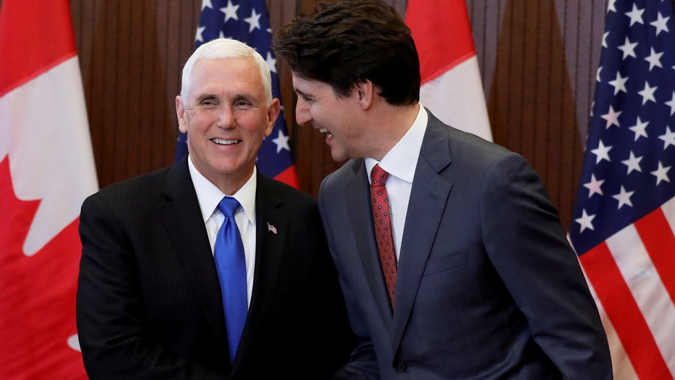 Canada PM Justin Trudeau and US Vice President Mike Pence shake hands in Ottawa