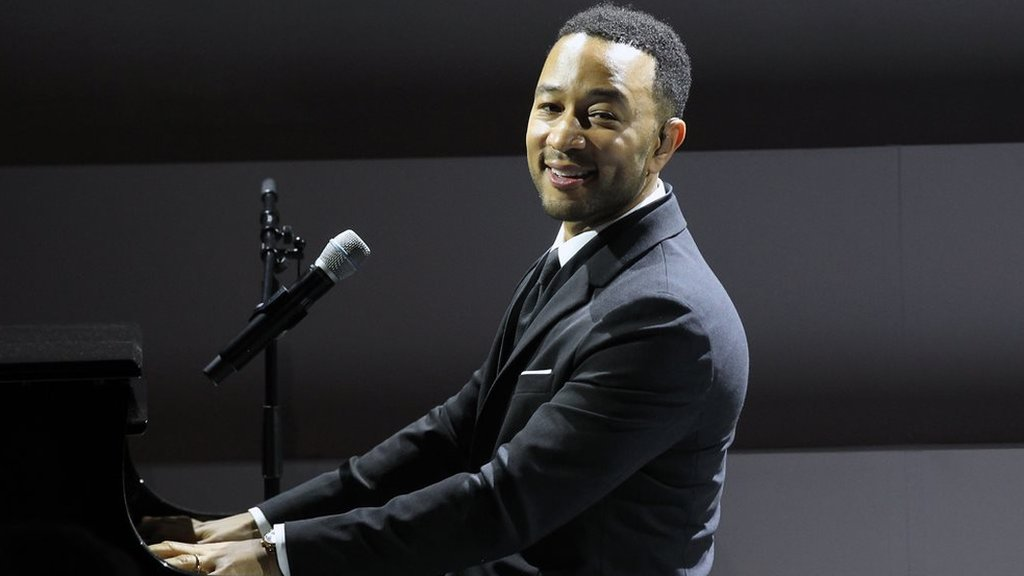 John Legend urging action on guns