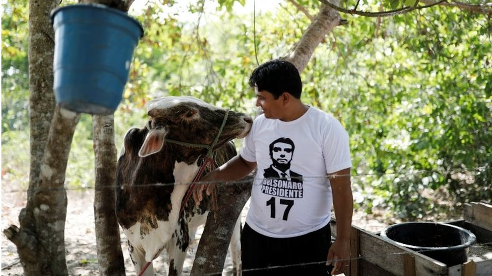A farmer wears a Bolsonaro T-shirt