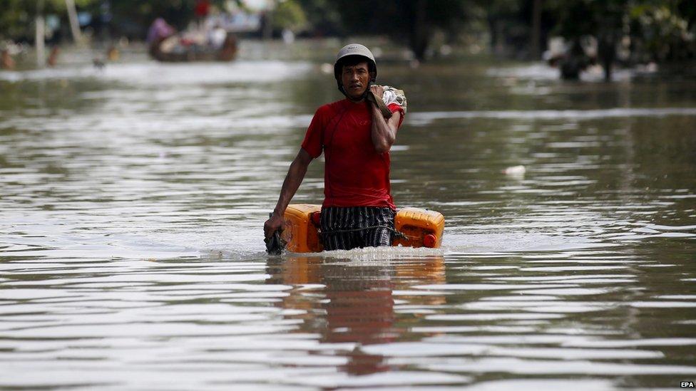 Man wades through floodwater outside Kale township in Sagaing, Myanmar (3 Aug 2015)