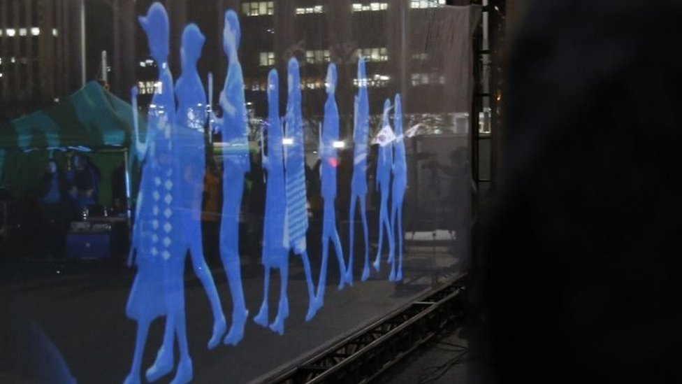 Holograms of protesters in Seoul. Photo: 24 February 2016