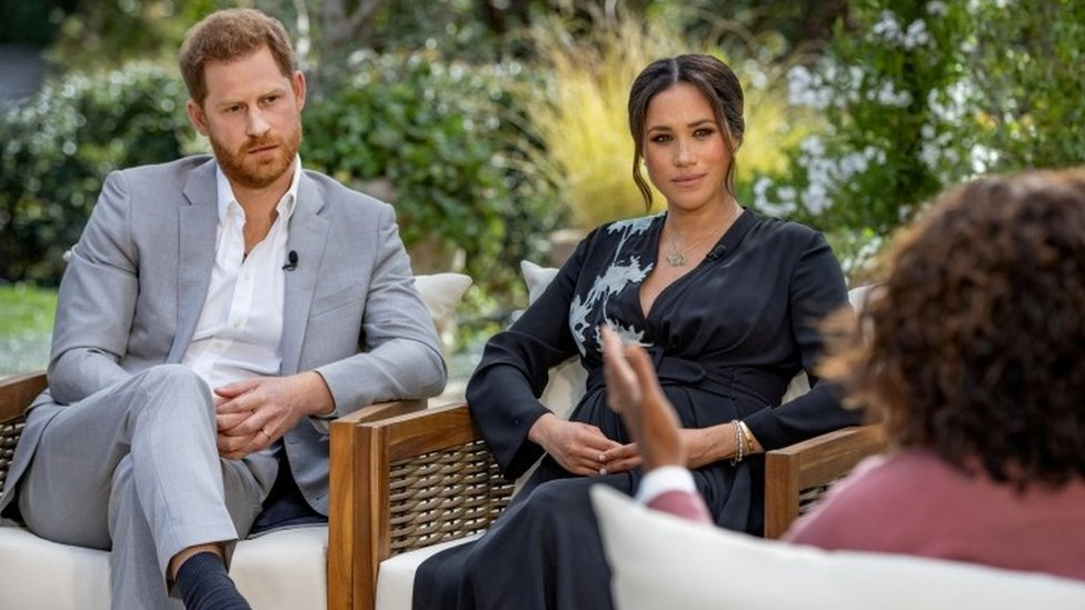 Prince Harry and Meghan being interviewed by Oprah