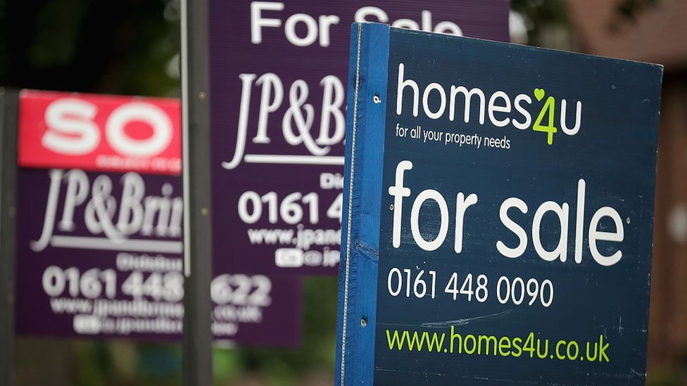 For Sale boards stand outside homes in Didsbury on August 2, 2016 in Manchester