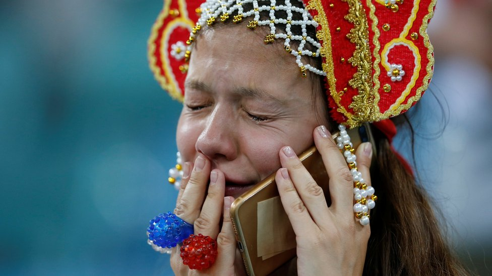 Russian fan cries at the end of the teams quarter-final match against Croatia, 7 July 2018
