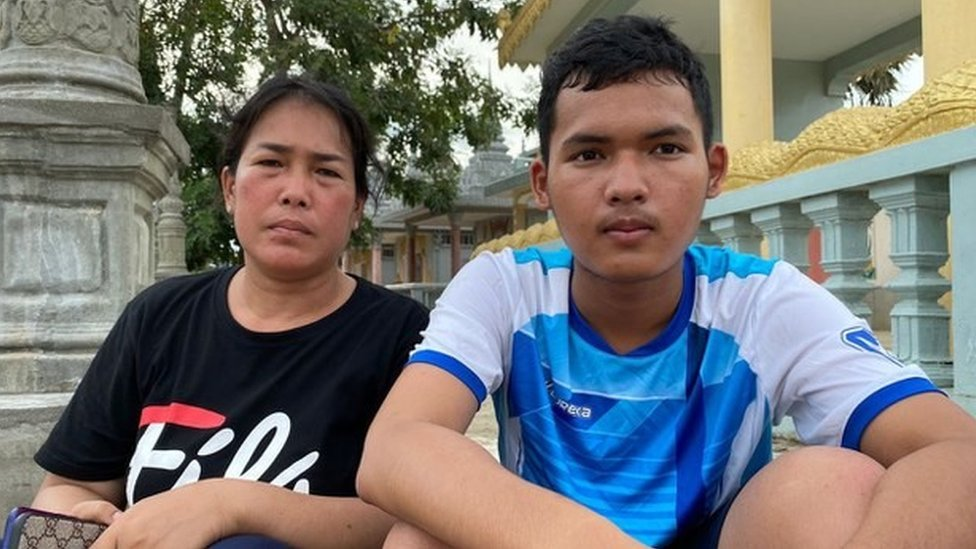 Prum Chantha and her son sit at a Buddhist temple in Phnom Penh