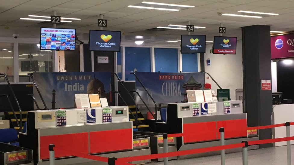 Closed Thomas Cook check-in desk at Cardiff airport