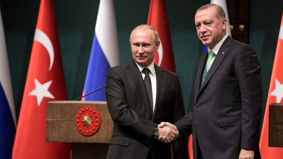 Turkish President Recep Tayyip Erdogan (right) shake hands with Russian President Vladimir Putin after their joint press conference at the Presidential Complex in Ankara on 11 December 2017