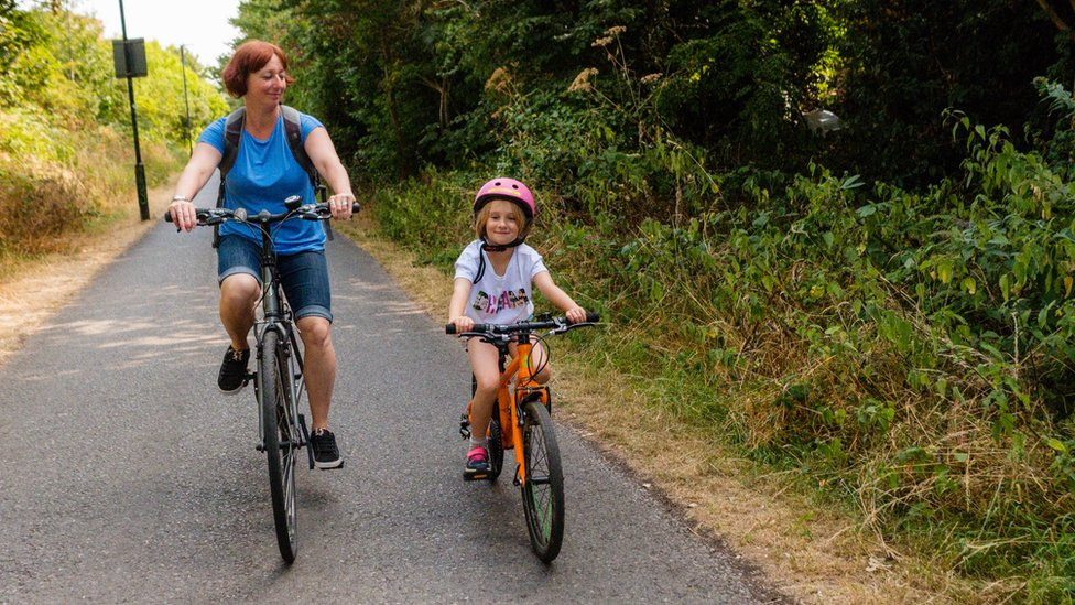 Woman and child on cycle path