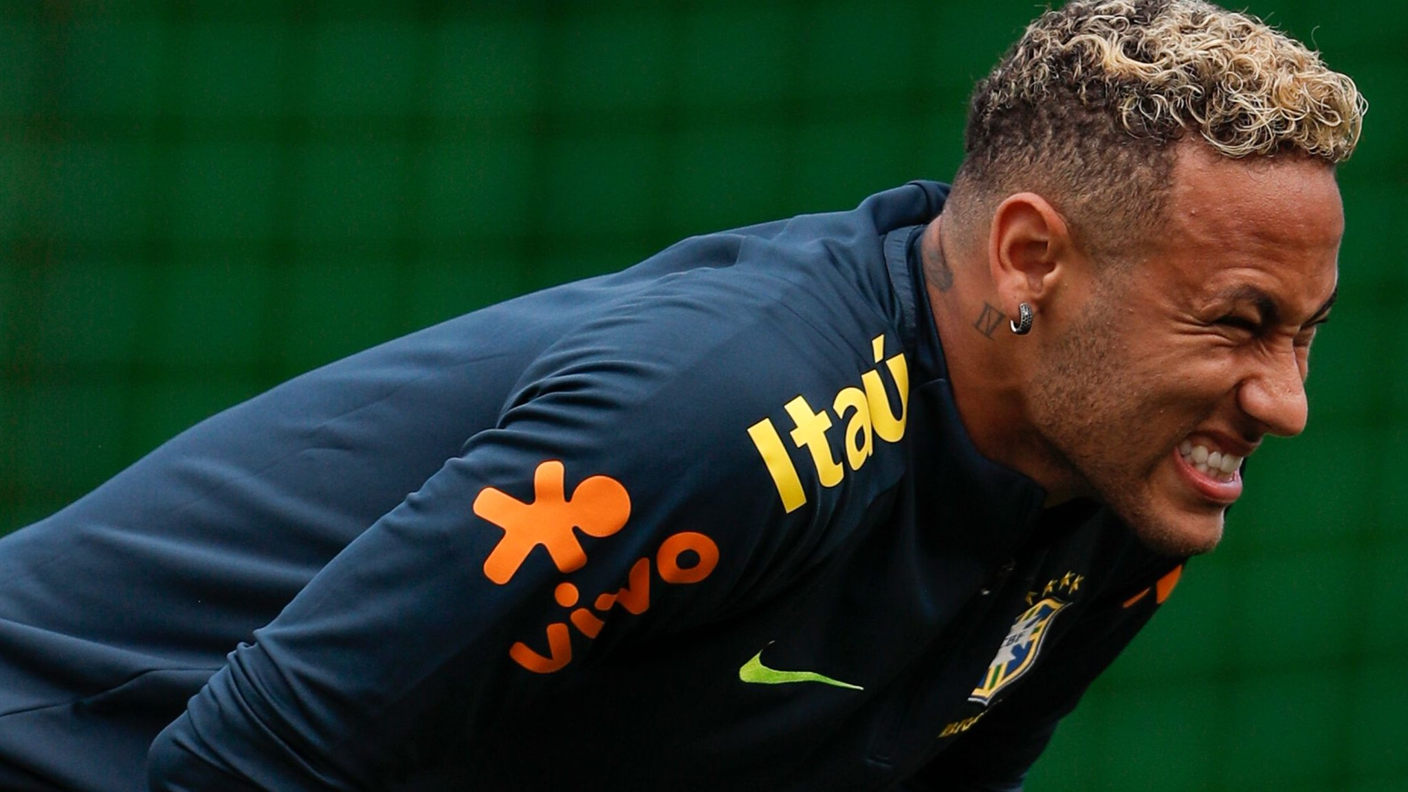 Injured Neymar limps out of Brazil training