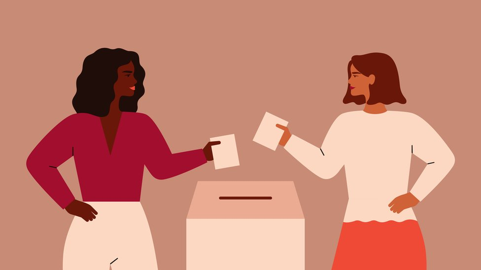 Women posting ballots