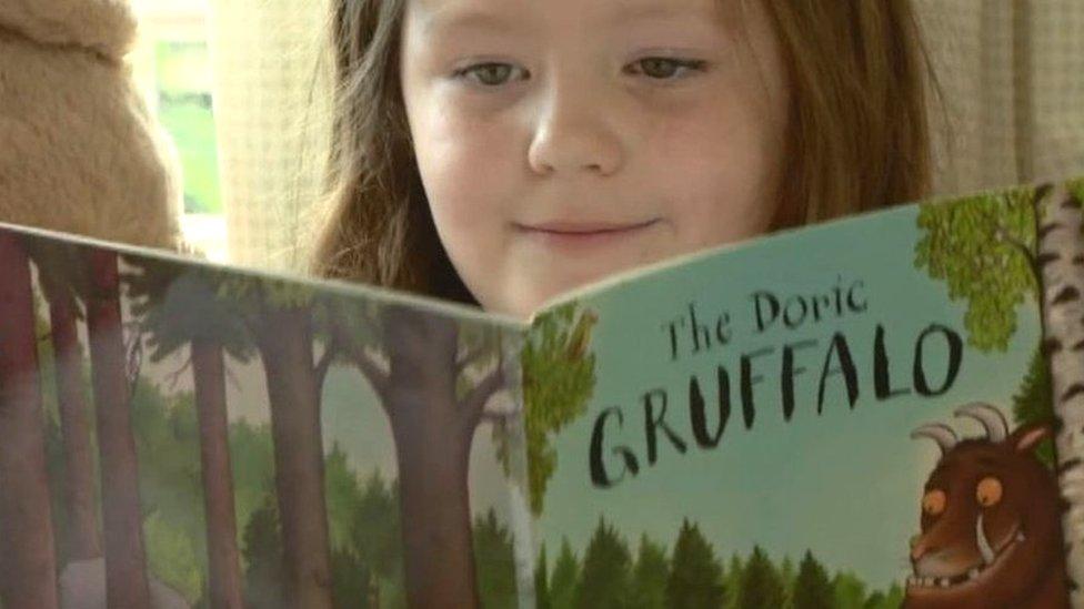 Girl reading The Doric Gruffalo
