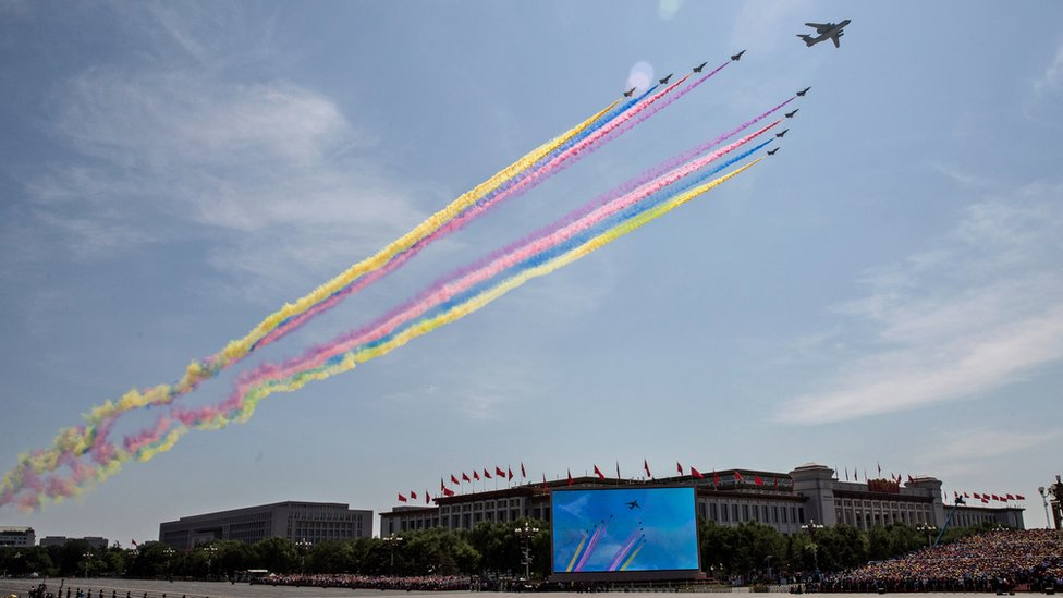 Aircraft fly in formation over Beijing releasing coloured smoke - 2015