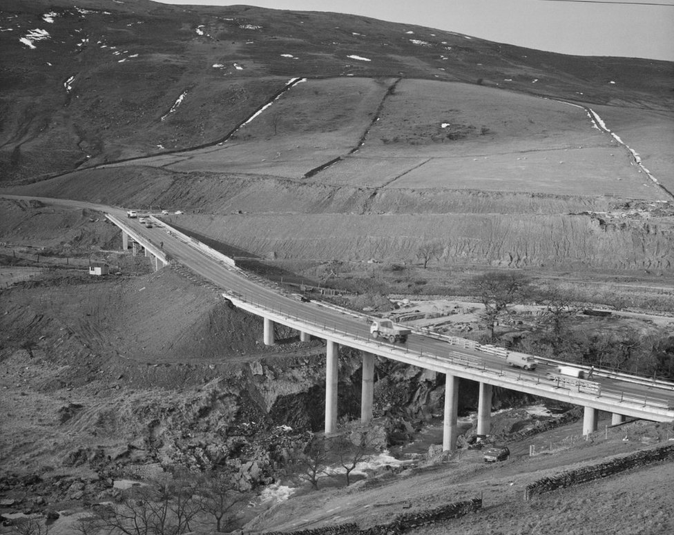 A view of the construction of the M6 Motorway through the Lune Gorge, showing the Roger Howe bridge carrying the A685 over the River Lune on 27 February, 1970
