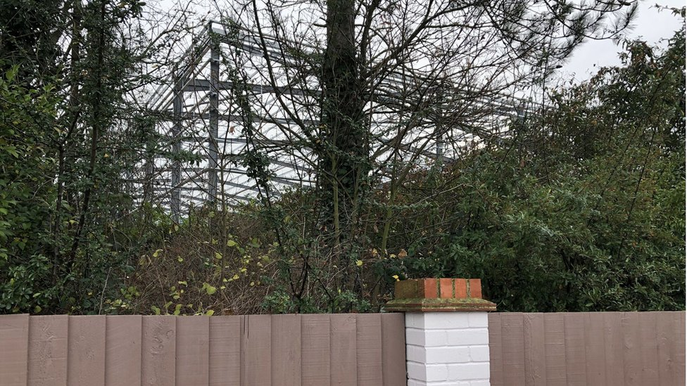 View of a warehouse from a back garden