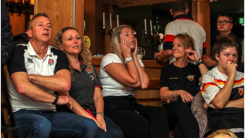 Dejected England fans at Crewe and Nantwich RFC, Nantwich.