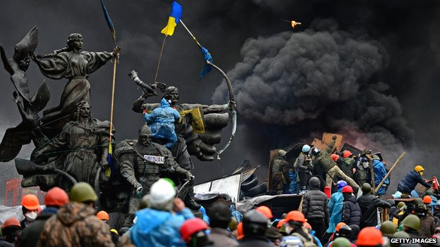 Anti-government protesters clash with the security forces in Independence Square in Kiev on 20 February
