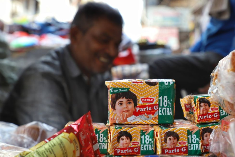 A vendor sells Parle Parle-G biscuits outside a metro station in New Delhi on 08 September 2019.