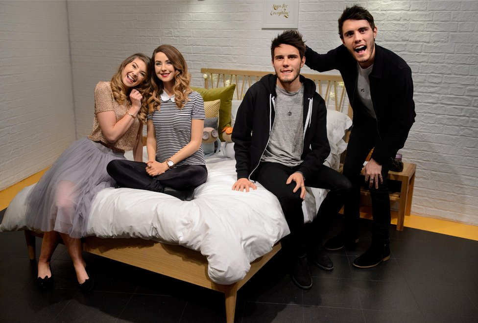 Zoe Sugg and Alfie Deyes with their wax figures at Madame Tussauds