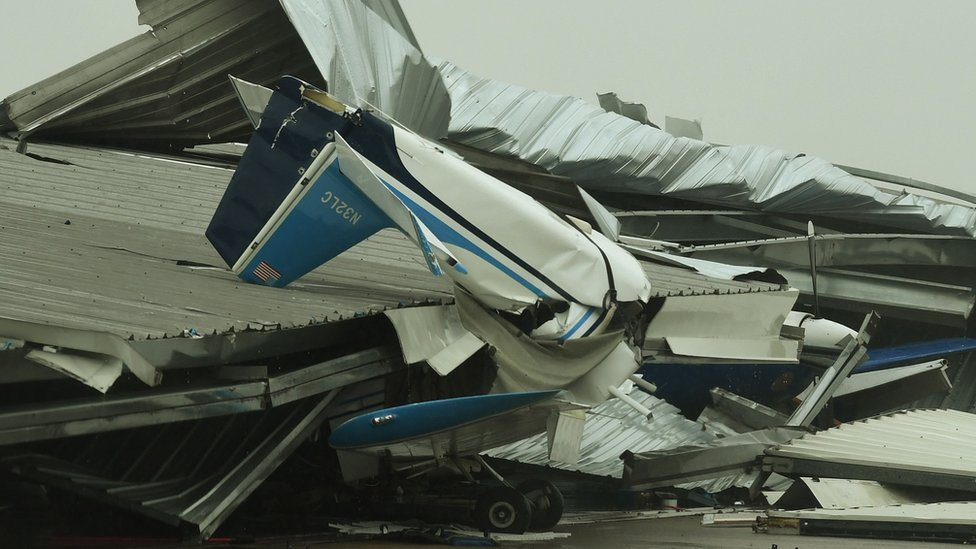 A badly damaged light plane in its hanger at Rockport Airport after heavy damage when Hurricane Harvey hit Rockport, Texas on August 26, 2017.