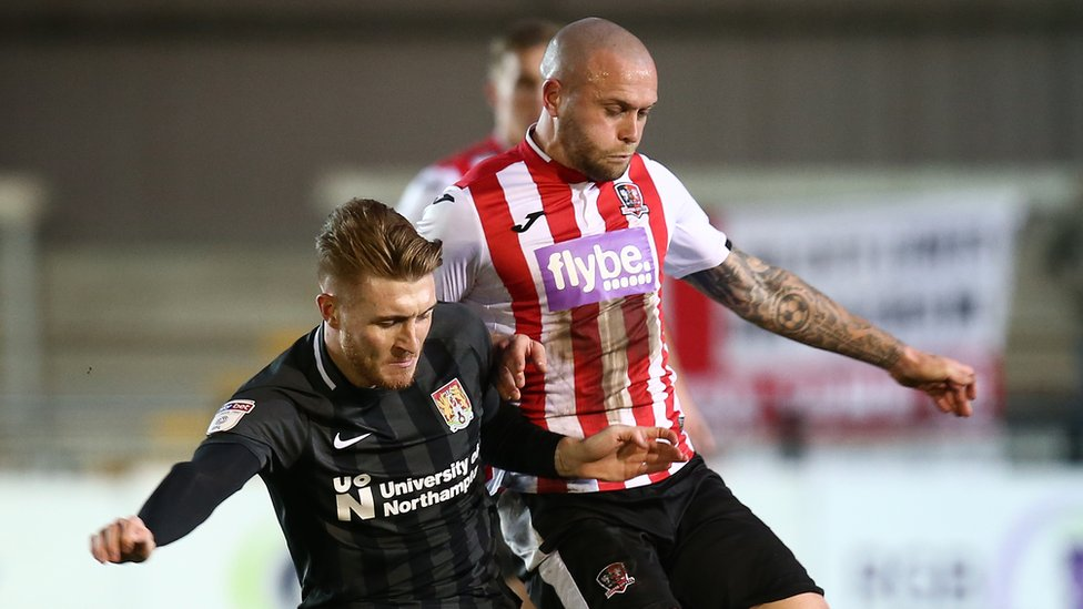 Nicky Law of Exeter City wearing shirt with Flybe logo
