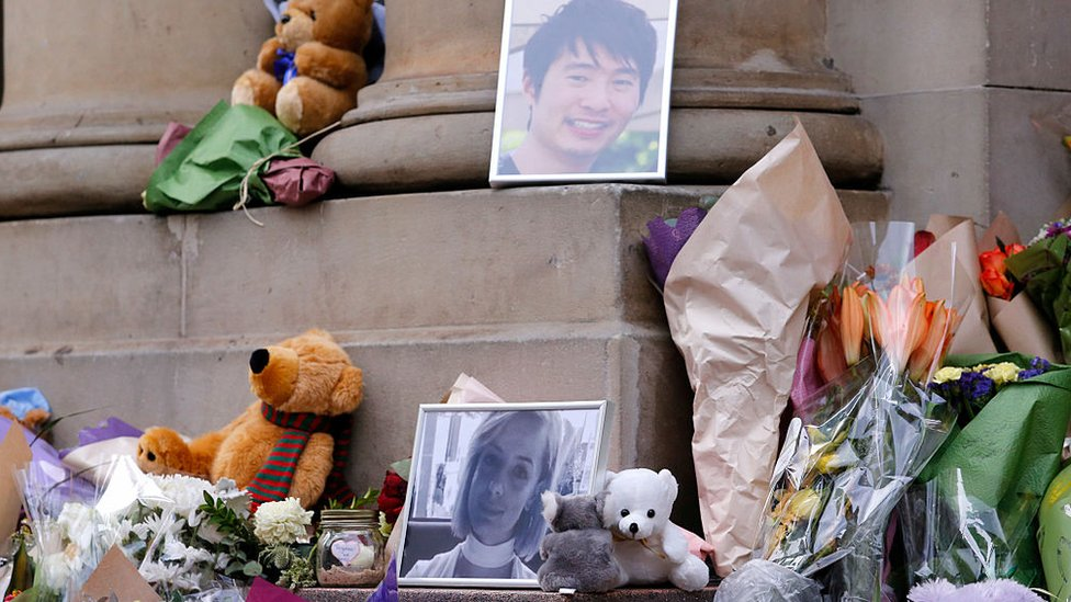 A makeshift memorial in 2017 featuring flowers, a soft toy, and photos of victims Matthew Si and Jess Mudie