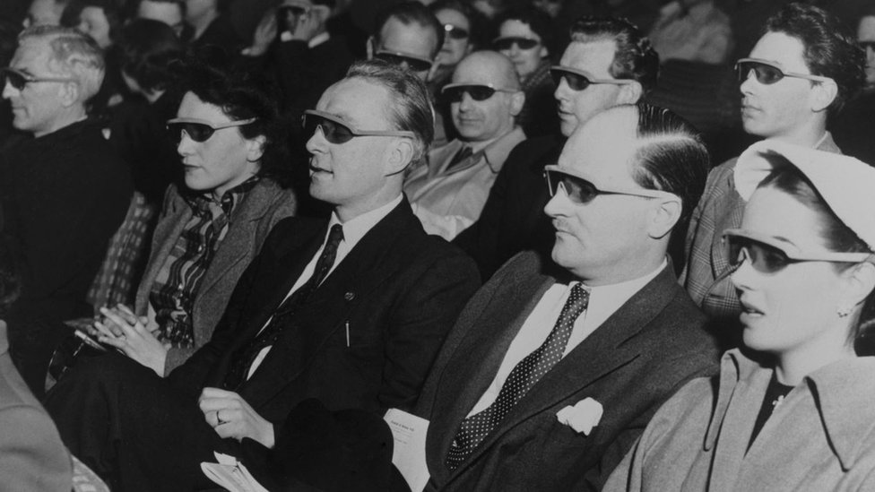 An audience wearing stereoscopic spectacles watching Telecinema, 1951
