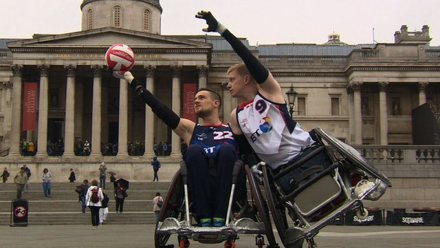 Two wheelchair rugby players posing for a photo.