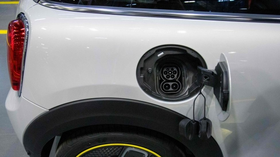 Electric charging point on a car