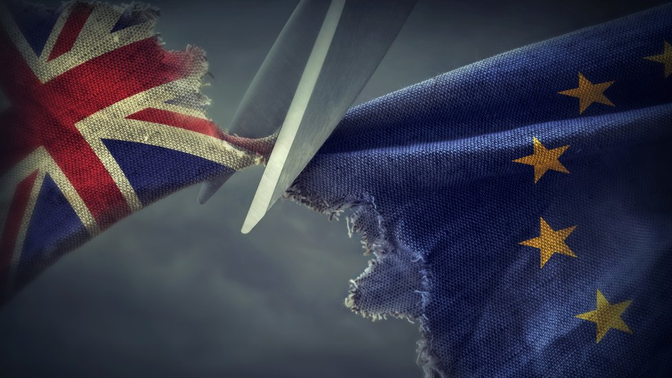 Scissors cutting the British flag from the EU flag