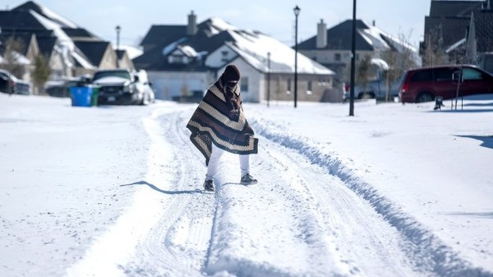 A Texan wearing a poncho in the snow