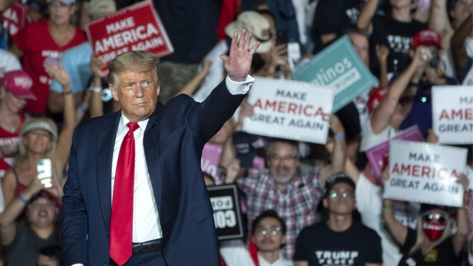 President Donald Trump waves to the crowd at a rally in Sanford, FL 12 October 2020