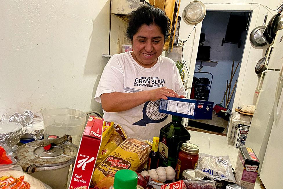 Ana's mom putting away groceries